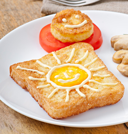 Jolly egg sandwich decorated with mushrooms and tomatoes photo