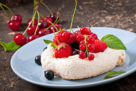 Cake  Pavlova  with cream and berries photo