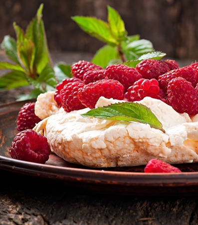 Cake  Pavlova  with cream and berries photo