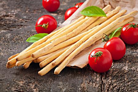 grissini: Grissini bread sticks on old wooden background