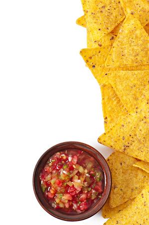 nachos and fresh salsa dip on white background photo
