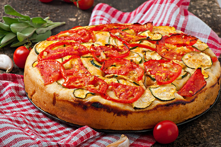Focaccia with tomatoes and garlic photo