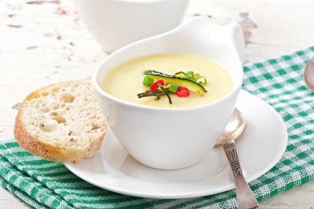 Zucchini cream soup with garlic and chilli photo