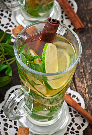 Moroccan tea with mint, lime and cinnamon photo