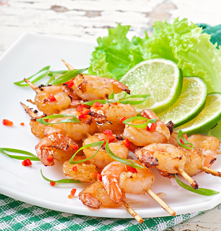 Shrimp grilled in garlic and soy caramel photo