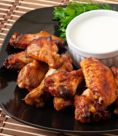 Baked chicken wings in the Asian style photo