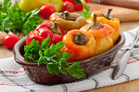 Stuffed peppers minced chicken with carrots with tomato sauce photo