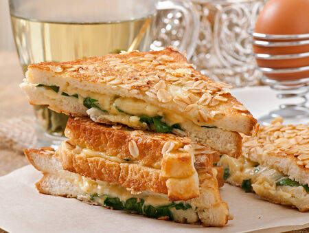 Warm toast with cheese and spinach for breakfast photo