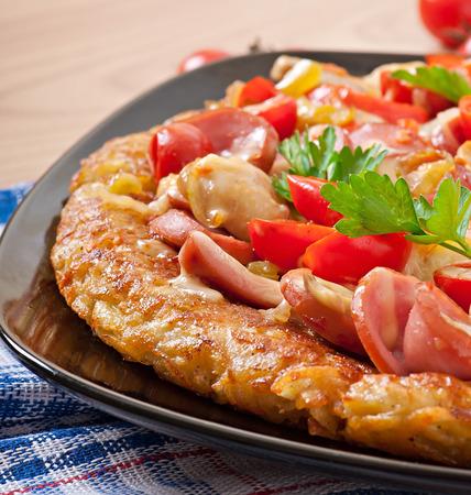 Potato gratin - pizza with sausage, mushrooms and tomatoes photo