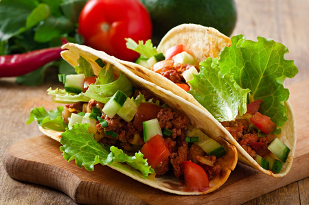 taco tortilla: Mexican tacos with meat, vegetables and cheese