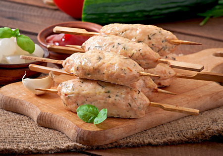 Kebab of minced chicken with dill and parsley photo