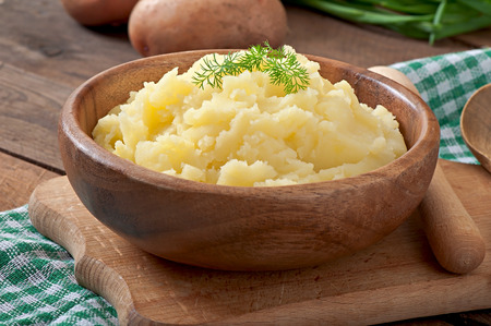 Fresh and flavorful mashed potatoes with wooden bowl