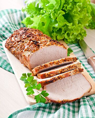 baked meat: Cut pieces of baked meat on the table Stock Photo