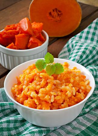 Pumpkin porridge in white bowl photo