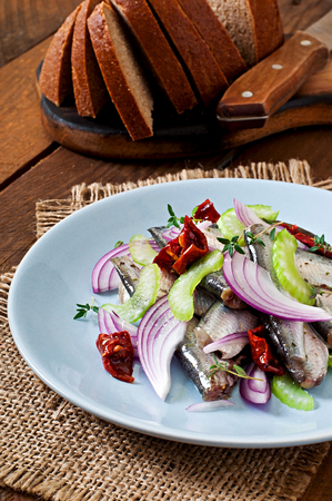 sundried: Herring salad with sun-dried tomatoes, celery and red onion. Stock Photo