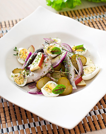 european anchovy: Herring salad, apples and eggs