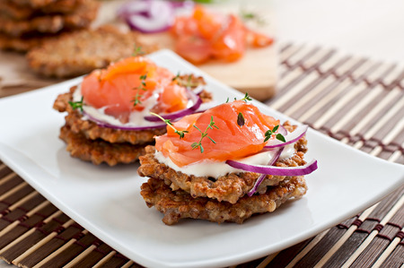 Buckwheat pancakes with salted salmon and sour cream close up Stock Photo - 39128330
