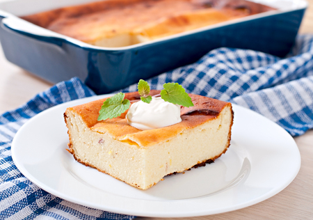 cheese cake: Appetizing cottage cheese casserole on white plate close up