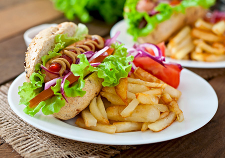 hotdog sandwiches: Hot Dogs with French fries on white plate, close-up.