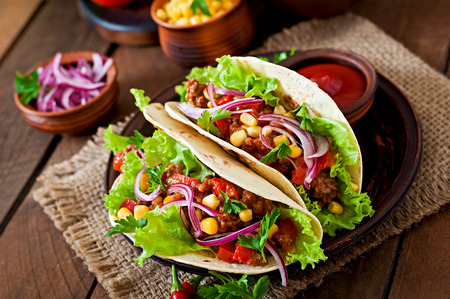 taco: Mexican tacos with meat, vegetables and red onion Stock Photo