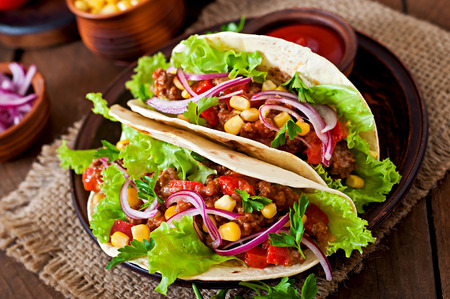 mexican food: Mexican tacos with meat, vegetables and red onion Stock Photo