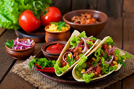 tacos: Mexican tacos with meat, vegetables and red onion Stock Photo