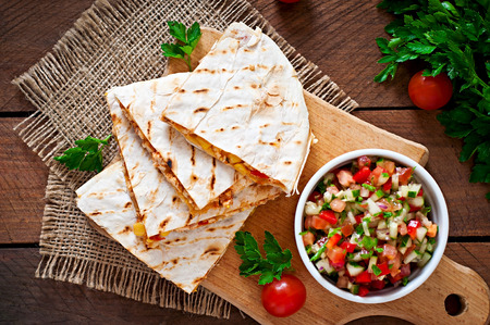 corn salad: Mexican Quesadilla wrap with chicken, corn and sweet pepper and salsa