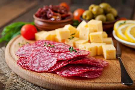 antipasto platter: Antipasto catering platter with salami and cheese on a wooden background