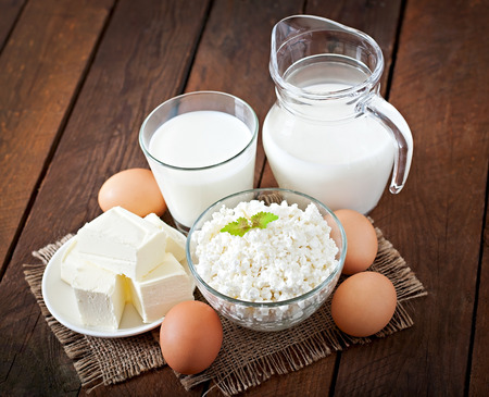 Dairy products and eggs on a wooden table