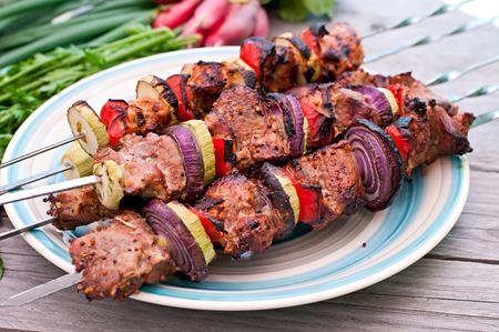 kebab: Juicy kebabs and grilled vegetables Stock Photo