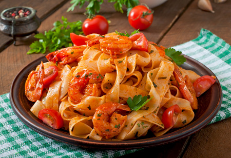 food: Fettuccine pasta with shrimp tomatoes and herbs