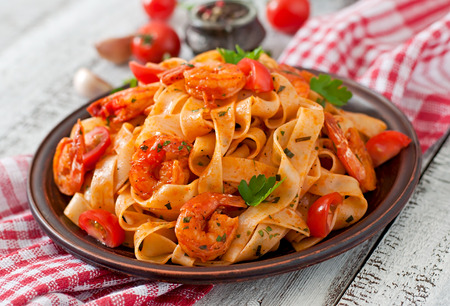 vegetarian food: ettuccine pasta with shrimp tomatoes and herbs