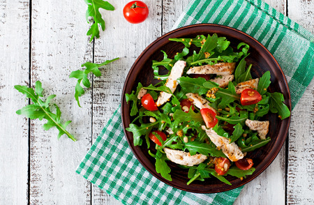 red breast: Fresh salad with chicken breast arugula and tomato