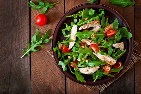 chicken breast: Fresh salad with chicken breast arugula and tomato