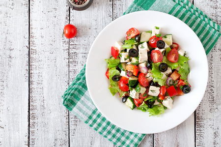 greek cuisine: Greek salad with fresh vegetables feta cheese and black olives