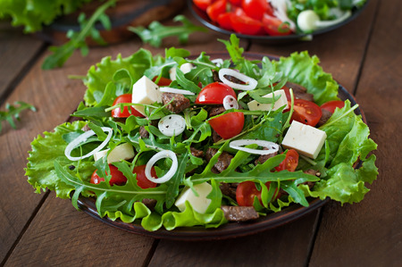 vegetable salad: Salad with veal slices, arugula, tomatoes and feta cheese