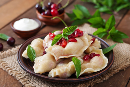sweet table: Delicious dumplings with cherries and jam