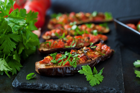 tomato: Baked eggplant with tomatoes, garlic and paprika Stock Photo