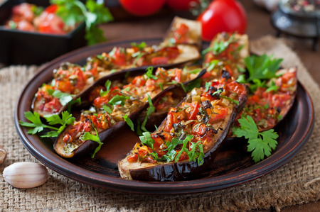 and organic: Baked eggplant with tomatoes, garlic and paprika Stock Photo