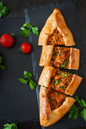 restaurant background: Turkish pide traditional food with beef and vegetables Stock Photo
