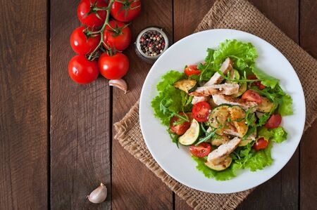 red breast: Salad of chicken breast with zucchini and cherry tomatoes Stock Photo