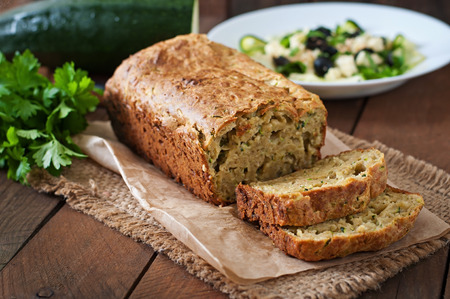 Zucchini bread with cheese on a wooden background 스톡 콘텐츠