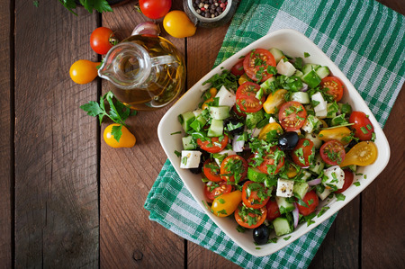 Greek salad with fresh vegetables, feta cheese and black olives