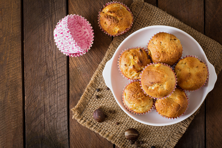 muffin: Fruit muffins with nutmeg and allspice on a wooden background