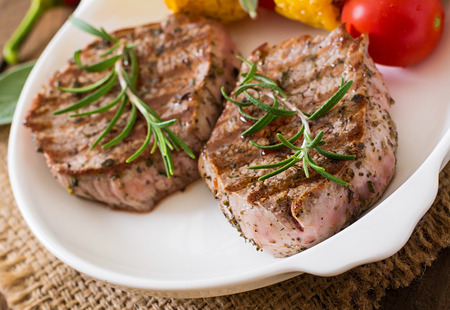Tender and juicy veal steak medium rare with vegetables Stock Photo