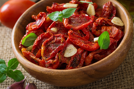 sundried: Sun-dried tomatoes with herbs and garlic Stock Photo
