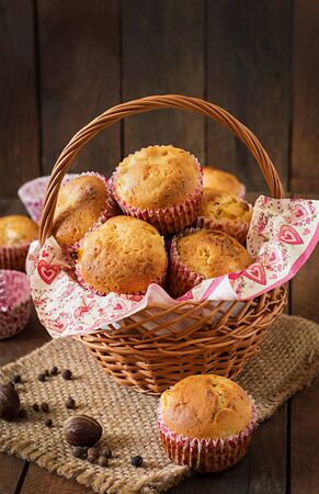 allspice: Fruit muffins with nutmeg and allspice on a wooden background