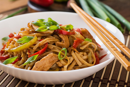 asian noodles: Udon noodles with chicken and peppers - Japanese cuisine. Stock Photo