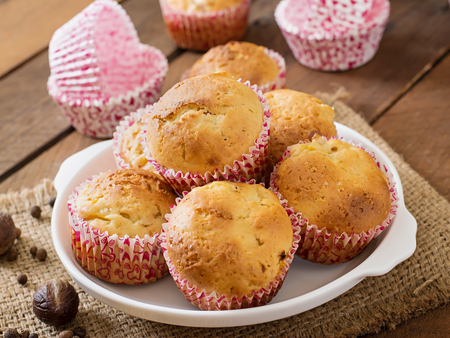 nutmeg: Fruit muffins with nutmeg and allspice on a wooden background