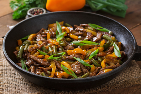 meat dish: Stir frying beef with sweet peppers and green beans